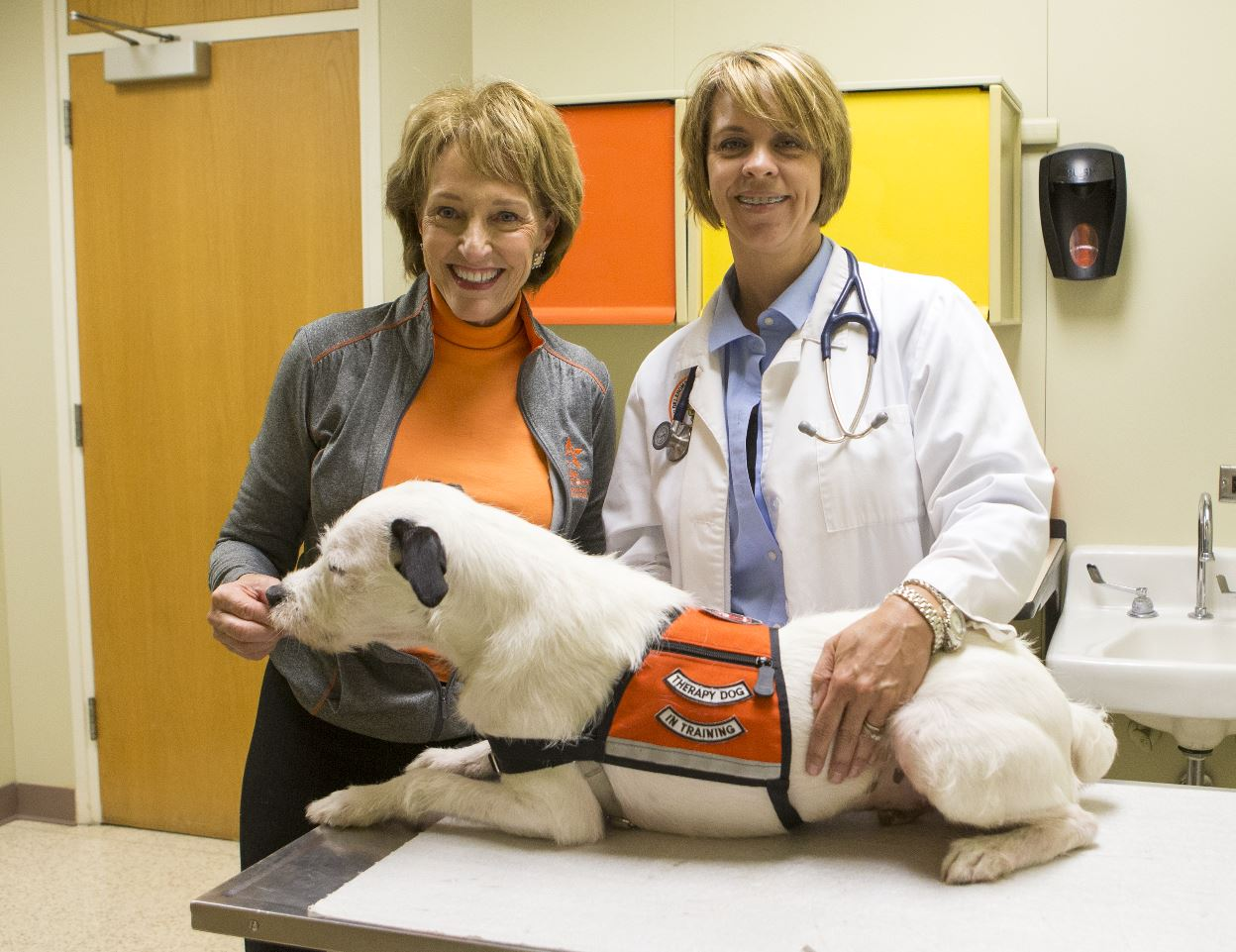 Dr. Lara Sypniewski and OSU First Lady Anne Hargis pose with a member of Pete's Pet Posse