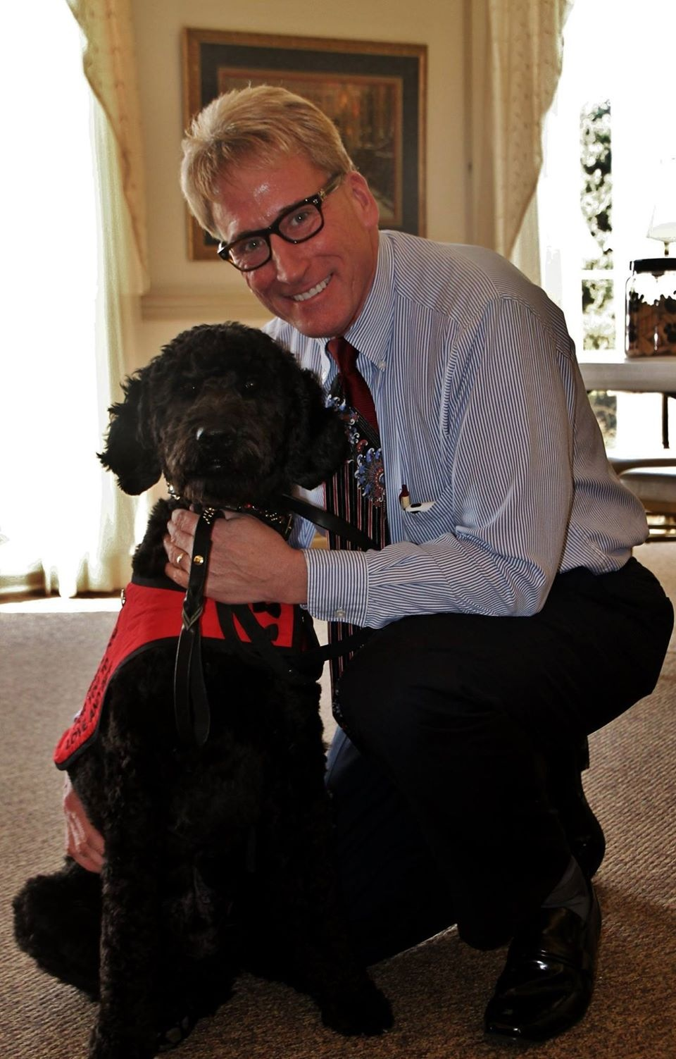 Owner Randy Grimes and Grief Therapy Dog Brooklyn