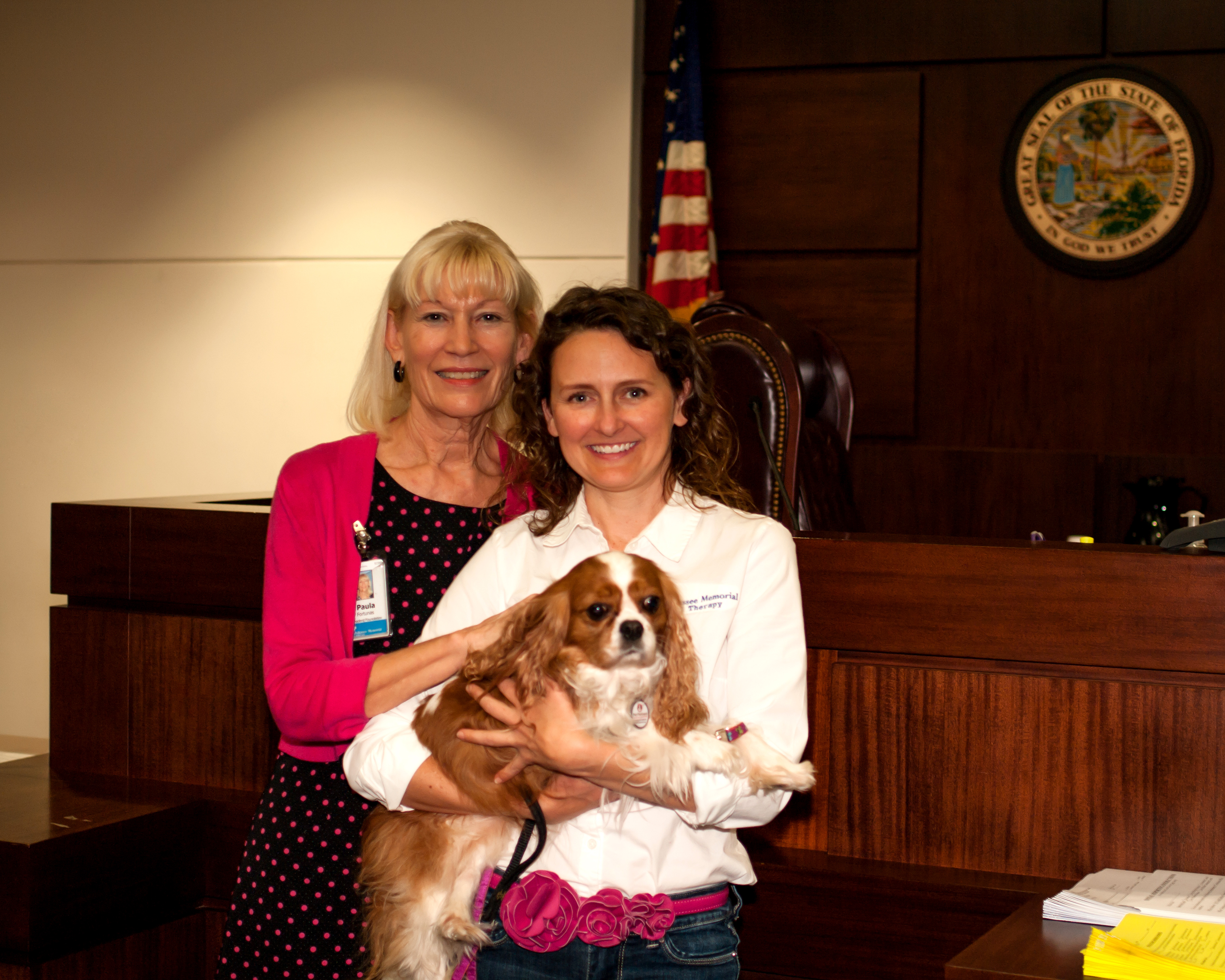 Tallahassee Memorial Animal Therapy Program Coordinator Stephanie Perkins Smiles with her dog and friend in the courtroom